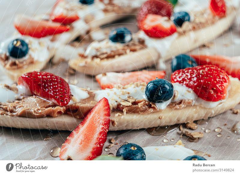 Banana Split With Strawberries, Blueberries, Almond Butter And Honey banana split Blueberry Strawberry Fresh Fruit Background picture Berries Summer Gastronomy