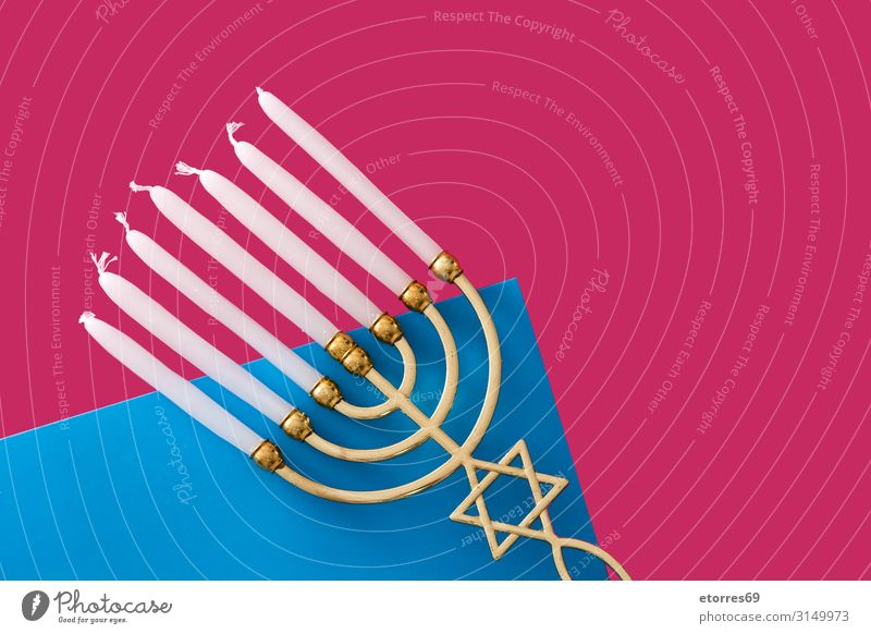 Jewish Hanukkah menorah on blue and pink background hanukkah Menorah-im Candle Illuminate Feasts & Celebrations Israeli Public Holiday Gold candelabrum Culture