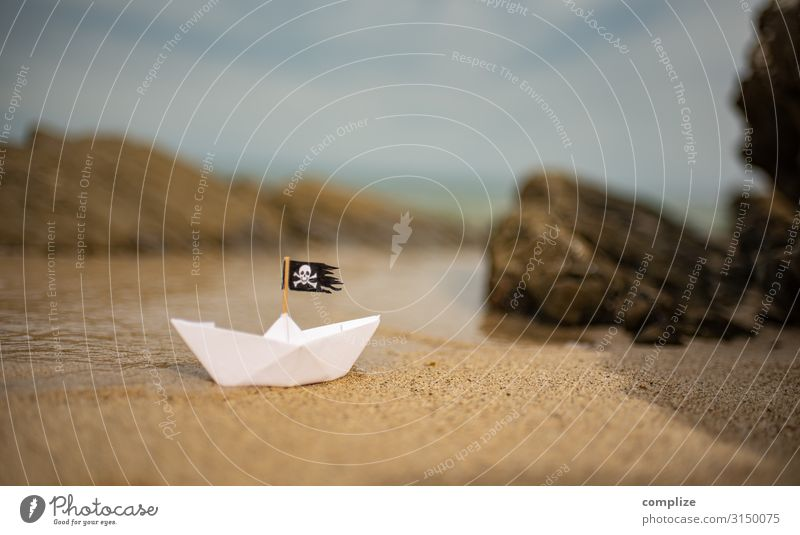 Pirate paper ship on the beach between cliffs Vacation & Travel Adventure Far-off places Expedition Summer Summer vacation Sports Swimming & Bathing Sailing