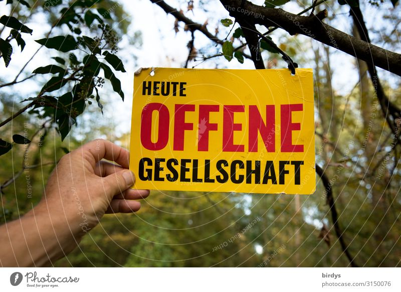 """One hand holds up a sign with the inscription """" Today Open Society """". Human being Life by hand Sky Forest Characters Signage Warning sign Exceptional Positive"""