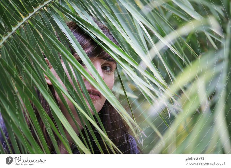 Woman Human being Youth (Young adults) Young woman Adults Life Emotions Smiling Observe Curiosity Protection Exotic Hide Long-haired Palm tree Brunette