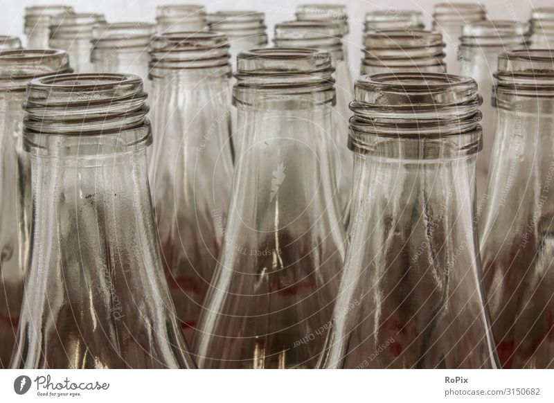 Rows of glass bottles. Food Beverage Bottle Glass Lifestyle Style Design Education Science & Research Work and employment Profession Workplace Factory Economy