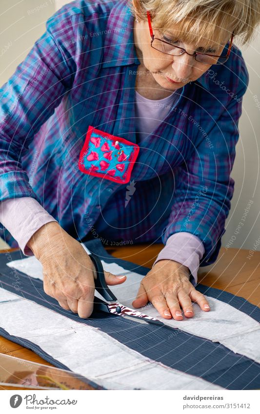 Dressmaker cutting a cloth Design Handicraft Table Work and employment Profession Craft (trade) Scissors Human being Woman Adults Fashion Clothing Old Authentic