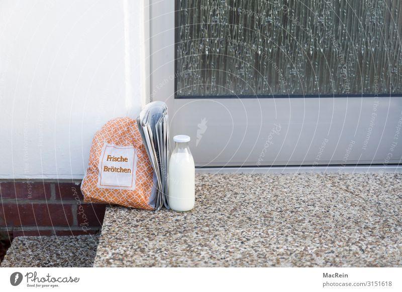 Breakfast on your doorstep Roll Milk Bottle Newspaper Magazine Healthy Prompt Front door Glassbottle Paper bag service Copy Space Colour photo Exterior shot