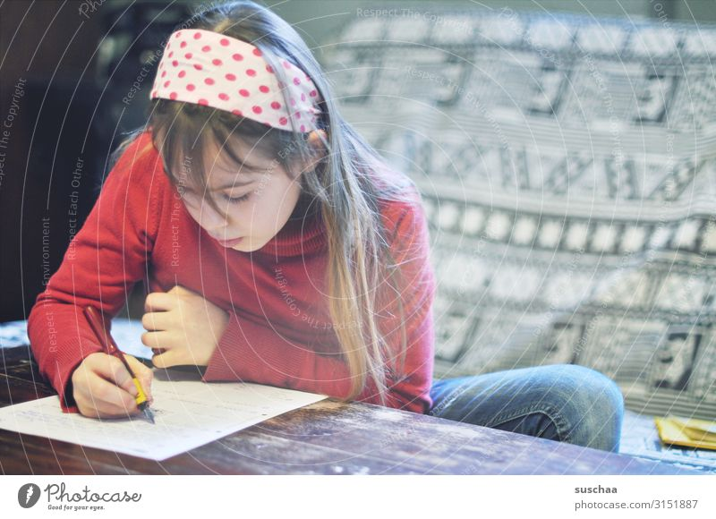 girl does her homework Child Girl at home Homework School Study Education Infancy Interior shot Homeschooling Quarantine Reading Write Schoolchild stay at home