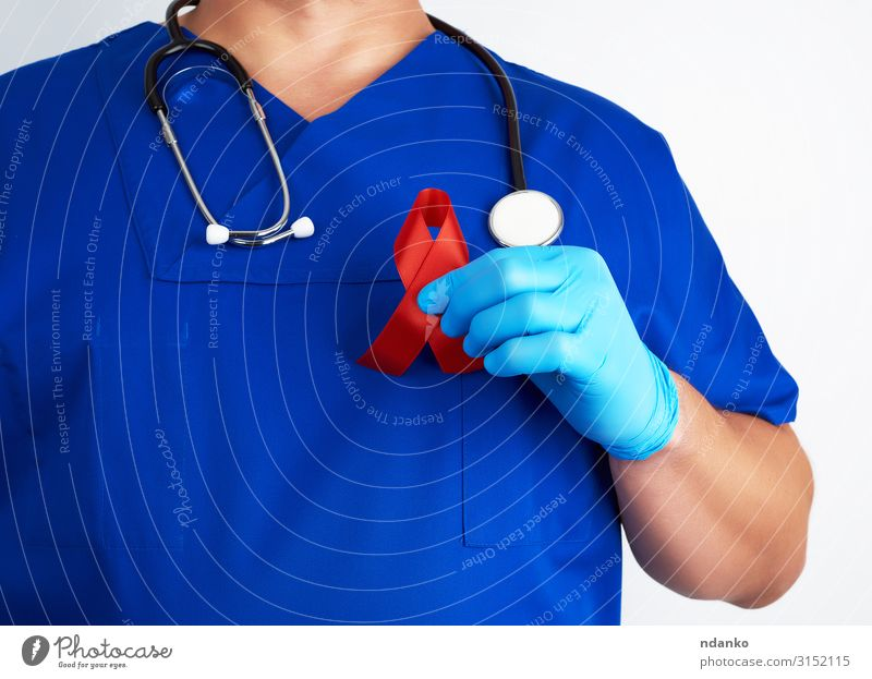 doctor holds a red ribbon Healthy Health care Medical treatment Illness Medication Doctor Human being Man Adults Hand Fingers Landmark String Red White Hope
