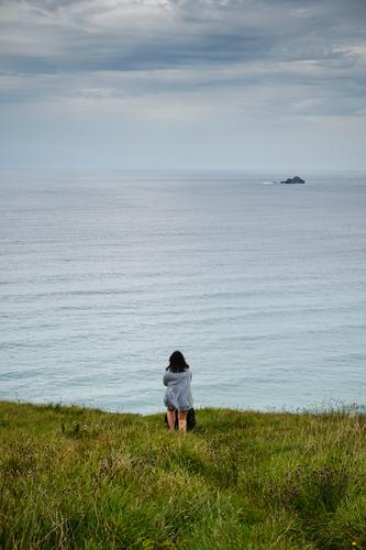 Woman at the sea with dog Freedom Summer Ocean Island Waves Feminine 1 Human being 18 - 30 years Youth (Young adults) Adults Environment Nature Landscape Water