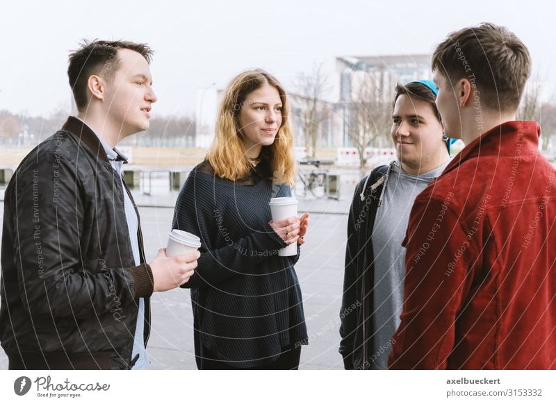 4 teenagers talking in the street Hot drink Coffee Latte macchiato Mug Lifestyle Joy Leisure and hobbies University & College student Human being Young woman
