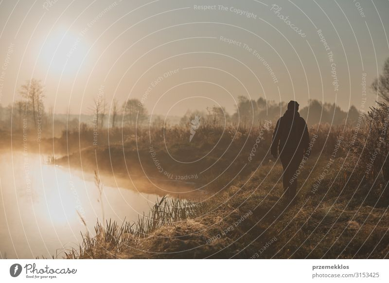 Sun rising above field and pond flooded with fog Woman Human being Vacation & Travel Youth (Young adults) Young woman Landscape Adults Autumn Meadow Grass Lake