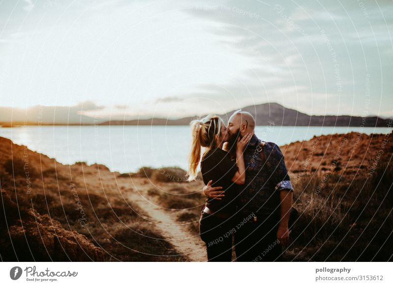 Couple kissing at sunset by the sea Future Together Attachment social distancing fortunate Funny in common Laughter heartfelt Contrast Rich in contrast Feminine