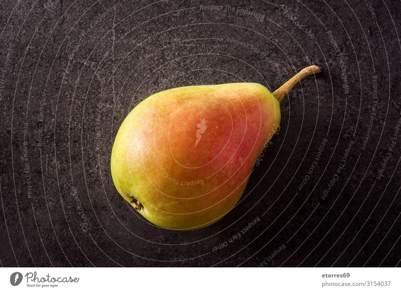 Healthy fresh pear on black background Healthy Eating Green Red Food photograph Natural Fruit Tradition Vegetarian diet Vegan diet Vitamin Snack Pear