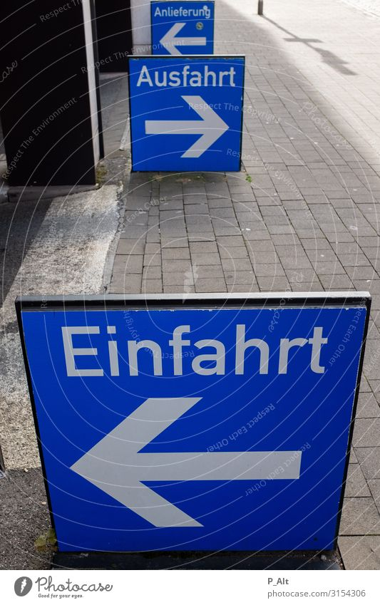 In-Out Münster Germany Town Parking garage Parking lot Highway ramp (entrance) Signs and labeling Highway ramp (exit) Delivery Transport Road traffic Motoring