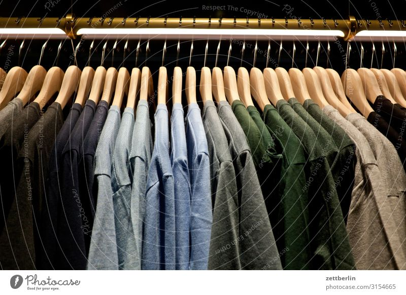 T-shirts Attract Selection Cotton Clothing Colour Color chart Play of colours Shopping Off-the-rack Store premises Deserted Summer clothing Shop window