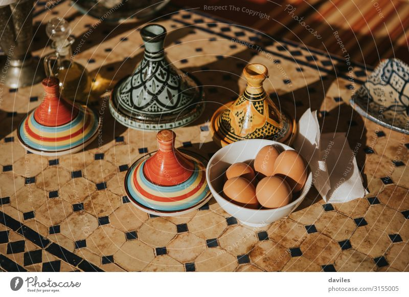 Typical moroccan tajines with food on a table Breakfast Plate Pot Decoration Art Culture Ornament Authentic Exotic Tradition Africa Cooking Dish Egg ethnic