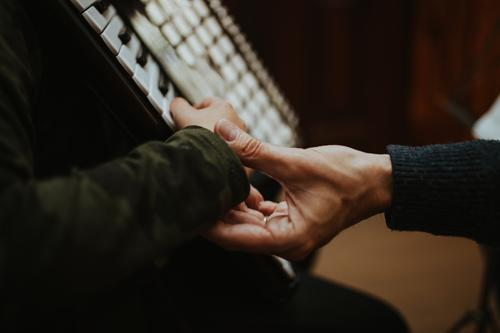 Teaching Accordion Lifestyle Education School Student Teacher Human being Hand Music Listen to music Musician Work and employment Touch Study Authentic Together