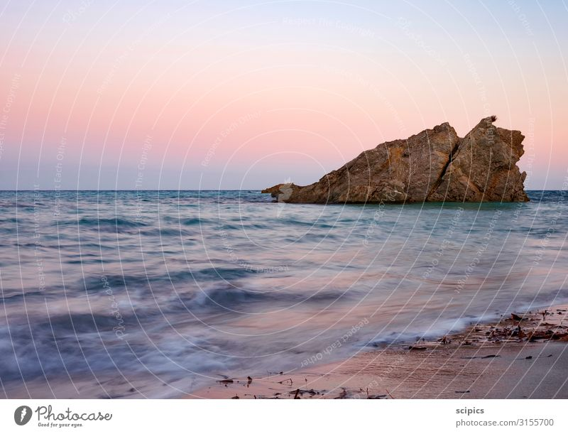 Rock in the surf Swimming & Bathing Sailing Environment Landscape Sand Air Water Cloudless sky Horizon Sunrise Sunset Spring Summer Beautiful weather Waves