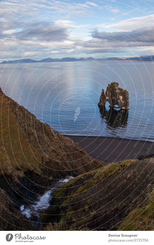 Troll rock in Iceland stands in the sea Vacation & Travel Tourism Adventure Expedition Summer Beach Environment Nature Landscape Climate Climate change