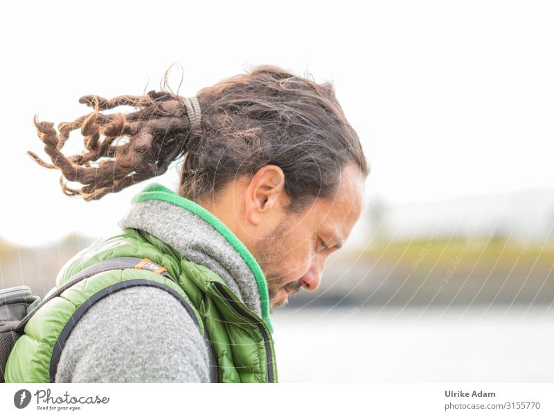 Dreadlocks in braid Masculine Man Adults Male senior Hair and hairstyles 1 Human being 45 - 60 years Brunette Long-haired Braids Reading Uniqueness Colour photo