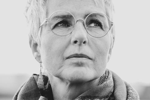 daydream Elegant Human being Feminine Woman Adults Female senior Senior citizen Head 1 45 - 60 years Earring Eyeglasses Think Dream Authentic Natural Black