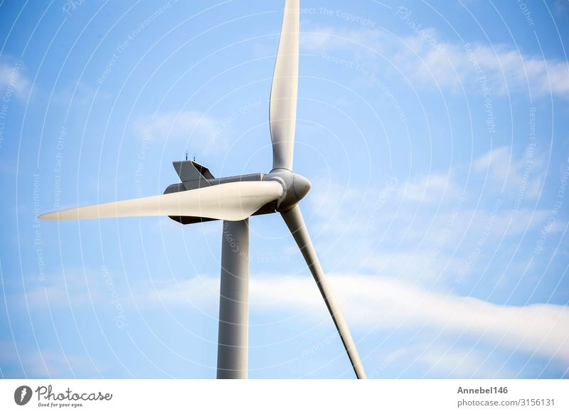 modern windmill on a sunny day and with idyllic white clouds Industry Technology Wind energy plant Environment Nature Landscape Plant Sky Clouds Grass Modern