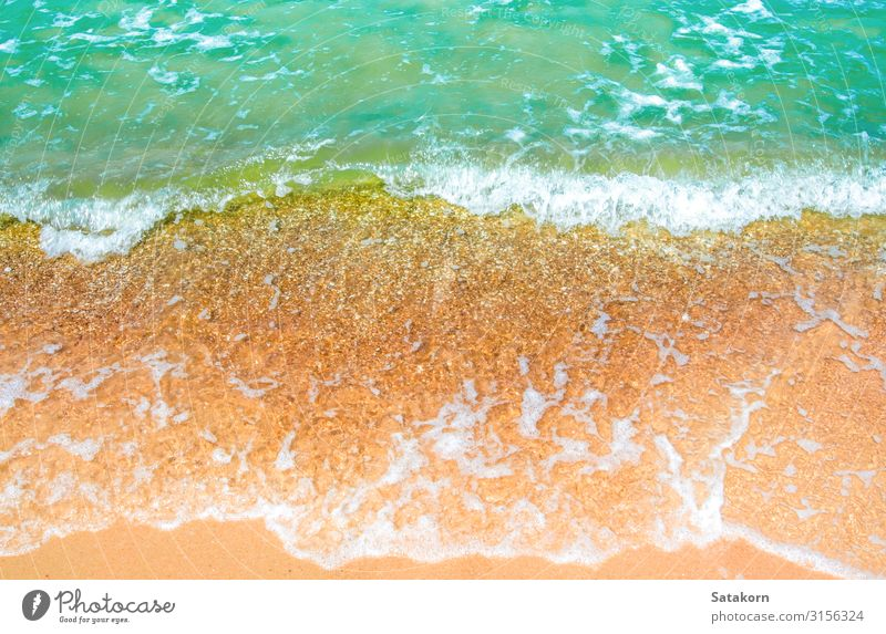 Bubble of clear sea wave on the beach Relaxation Vacation & Travel Beach Ocean Nature Sand Water Coast Blue Brown Green White bubble Splash movement background