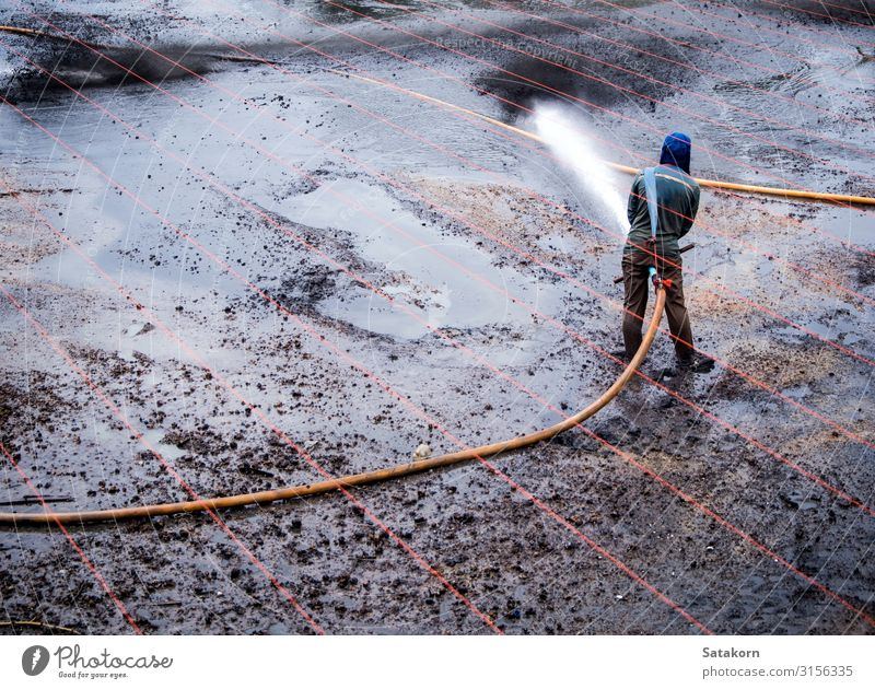 Cleaning the mud at the bottom of pond Work and employment Agriculture Forestry Human being Man Adults 1 Nature Landscape Drops of water Pond Rubber boots