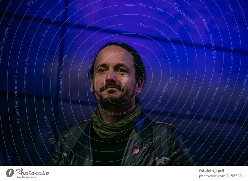 Man in blue, HH19. Masculine Adults Human being 45 - 60 years Jacket Rag Black-haired Long-haired Dreadlocks Facial hair Beard Observe Smiling Looking