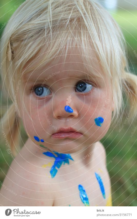 It wasn't me. Human being Feminine Child Toddler girl luck Positive Painted Carnival Finger paint portrait Half-profile Forward Looking away Infancy Happiness