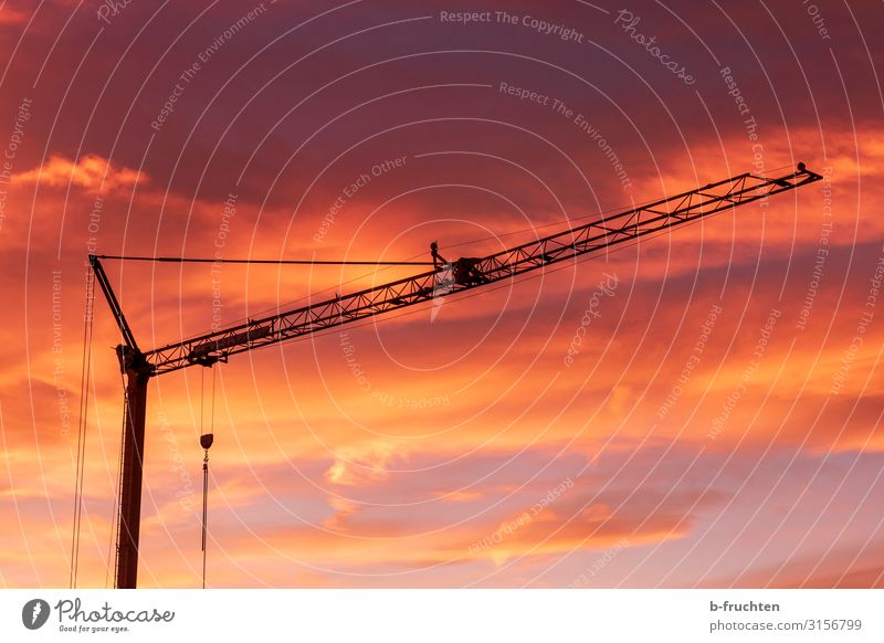 Building crane at sunrise Craftsperson Industry Craft (trade) Construction site Company Work and employment Dark Red Construction crane Clouds Silhouette