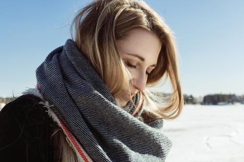 Closeup portrait of white female in a scarf on a frozen river Autumn Blonde Caucasian Coat Cold Face Young woman Hair Lifestyle Nature Exterior shot