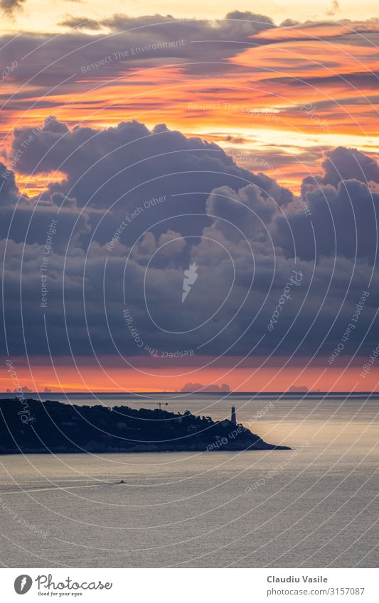 Lighthouse with a dramatic cloudy Sunrise Vacation & Travel Tourism Sightseeing Summer Summer vacation Sunbathing Water Clouds Mediterranean sea Cote d'Azur