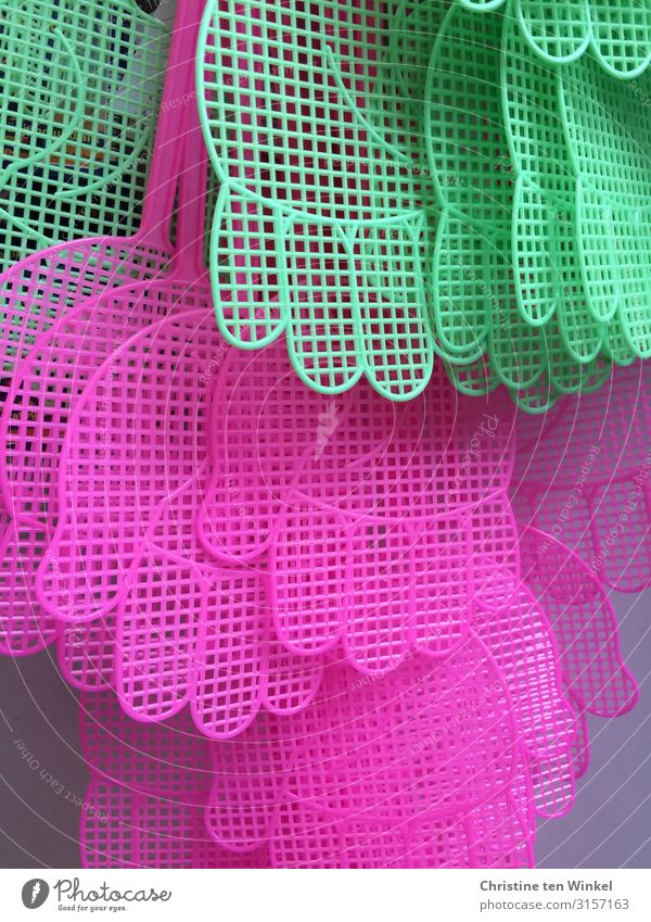 Fly swatters in hand shape in pink and green Kitsch Odds and ends Plastic Cool (slang) Brash Happiness Hip & trendy Funny Near Crazy Green Pink Bizarre Colour