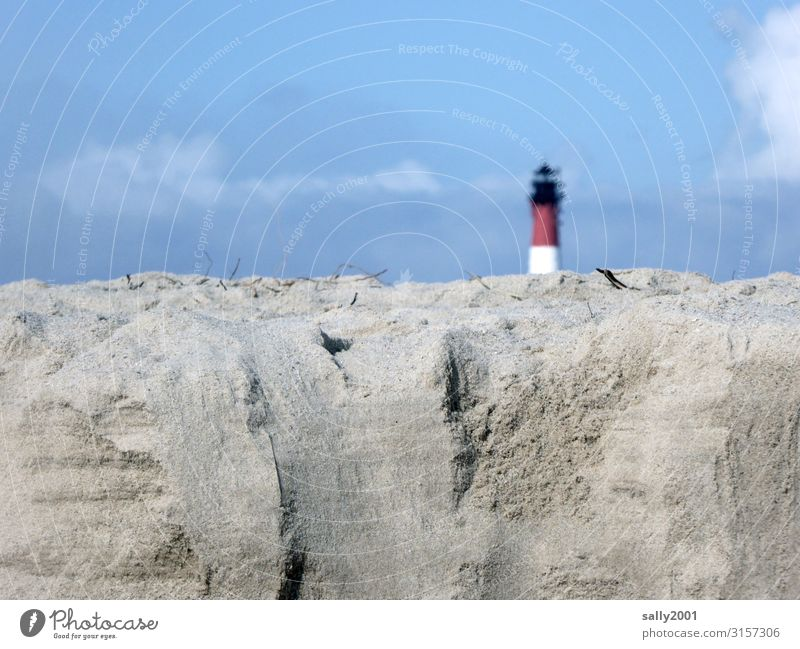 a lighthouse hides behind a lot of sand... Sand Lighthouse Tear-off edge Beach hörnum Sylt dune Blue sky Beautiful weather timid Vacation & Travel Sky Coast