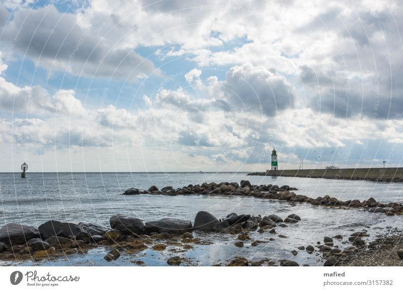 mucous Landscape Water Sky Clouds Autumn Beautiful weather Wind Coast Beach Baltic Sea Lighthouse Landmark Navigation Boating trip Fishing boat Sailboat Stone