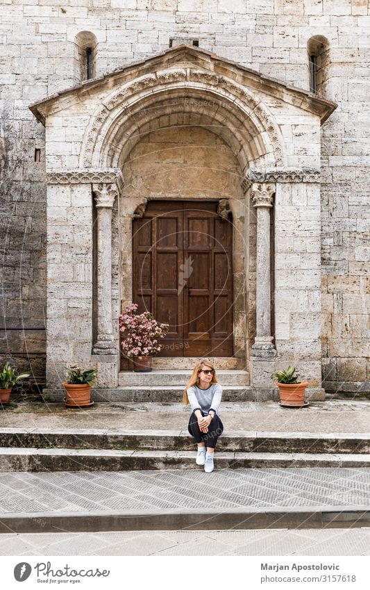 Young woman traveler sitting on the steps of an old church Woman Human being Vacation & Travel Youth (Young adults) Architecture Lifestyle Adults Feminine