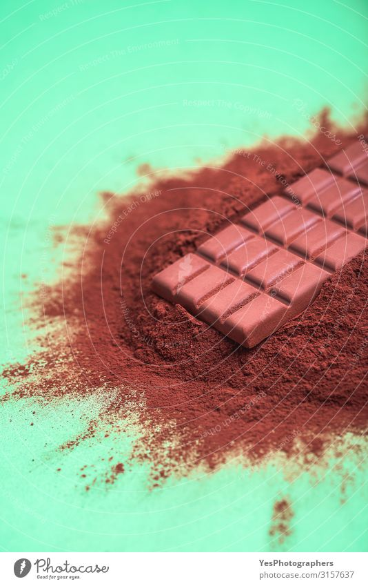 Cocoa powder pile and a milk chocolate bar Dessert Candy Chocolate Brown Tradition Christmas cooking background cacao powder Bar of chocolate chocolate chunk