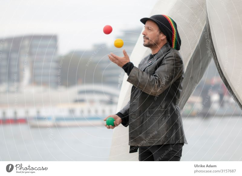 Artist juggles Juggle Juggler Ball Human being Masculine Man Adults Male senior 1 45 - 60 years street performer Hamburg Germany Town Port City Skyline Jacket