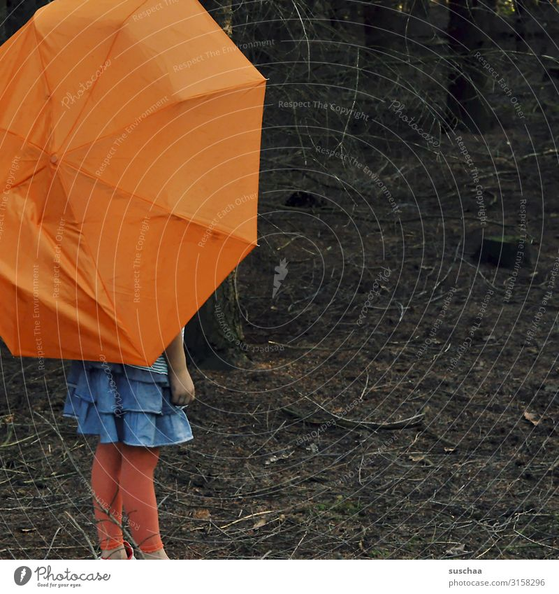 with umbrella in the forest Child Girl Umbrellas & Shades Undergrowth Forest Tree Branch Woodground Dark Loneliness Individual Multicoloured Orange Skirt Rain