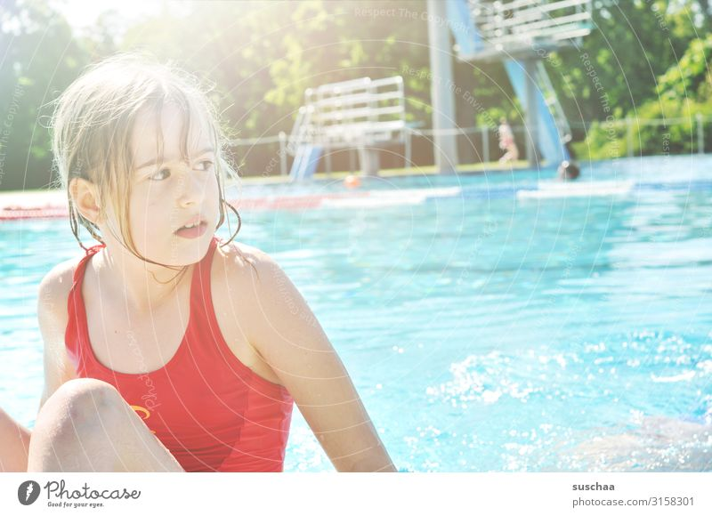child in swimming pool Child girl Swimming pool swimmer pool Water basin refreshingly Summer Hot Swimsuit Springboard Bright sunshine Relaxation