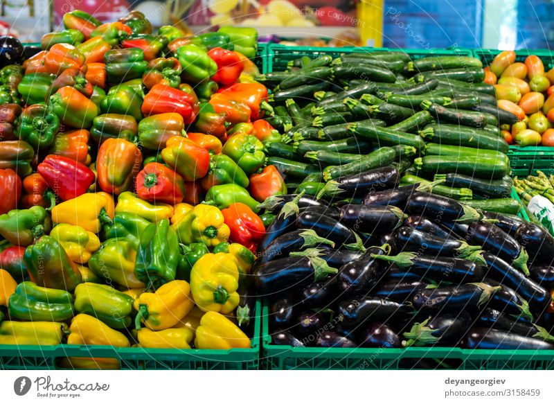 Arranged eggplants, peppers and zucchini. Food Vegetable Shopping Marketplace Stand Sell Supermarket Zucchini assortment Heap shelfs Variety Product