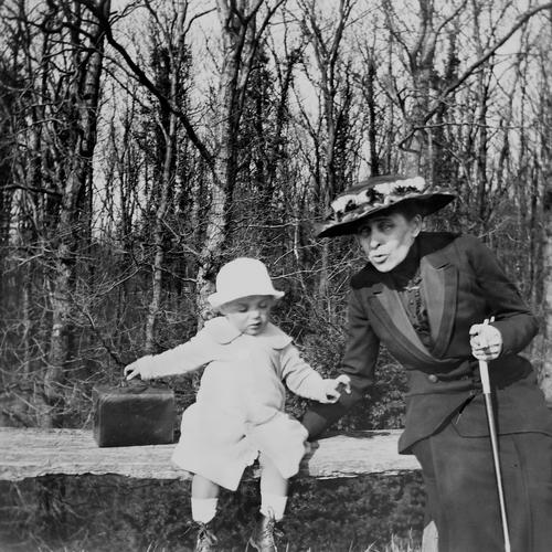 ready to leave Masculine Feminine Child Woman Adults Grandmother 2 Human being Beautiful weather Forest Dress Suitcase Walking stick Hat Bench Observe