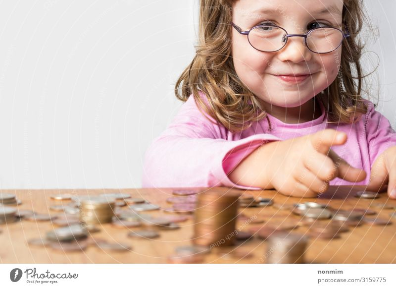 Smiling girl counting money for savings Money Save Playing Child School Economy Business Girl Eyeglasses Rich Future coins cash calculating deposit Dreamily