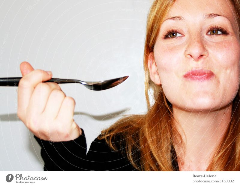 Young pretty woman enjoys the treat she has on her spoon and smiles mischievously Nutrition Spoon Lifestyle Healthy Flat (apartment) Young woman