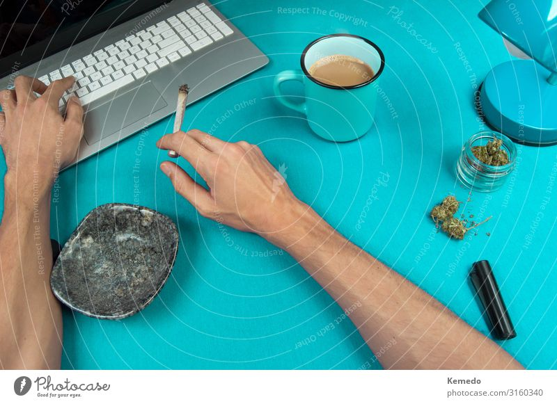 Smoking a marijuana joint while working in a blue table. Herbs and spices Breakfast Hot drink Coffee Espresso Cup Mug Lifestyle Luxury Style Design Joy