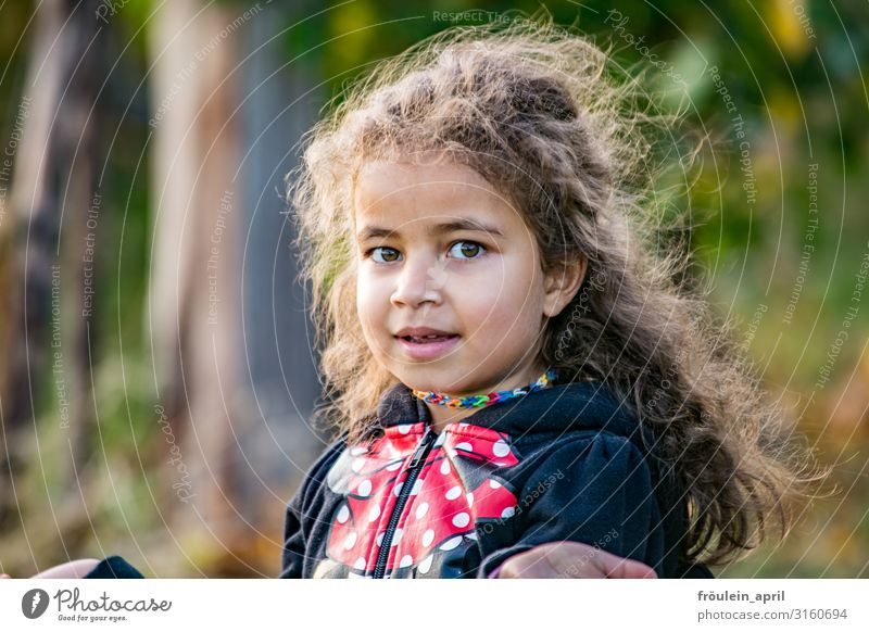 girl Hair and hairstyles Garden Child Feminine Girl 1 Human being 3 - 8 years Infancy Nature Jacket Brunette Long-haired Curl Smiling Free Friendliness