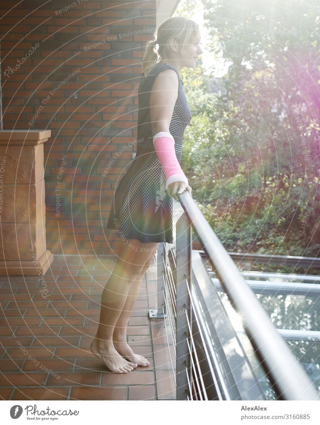 Young woman with plaster arm standing on a balcony railing Style Beautiful Life Balcony Handrail Brick wall Youth (Young adults) 18 - 30 years Adults Summer
