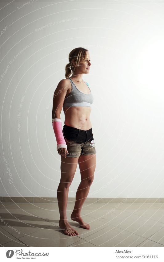 Young sportswoman with plastered arm Lifestyle Style Beautiful Athletic Fitness Sportsperson Young woman Youth (Young adults) low in gypsum Wound 18 - 30 years