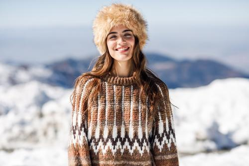 Young woman enjoying the snowy mountains in winter Lifestyle Elegant Happy Beautiful Hair and hairstyles Face Leisure and hobbies Winter Snow Mountain