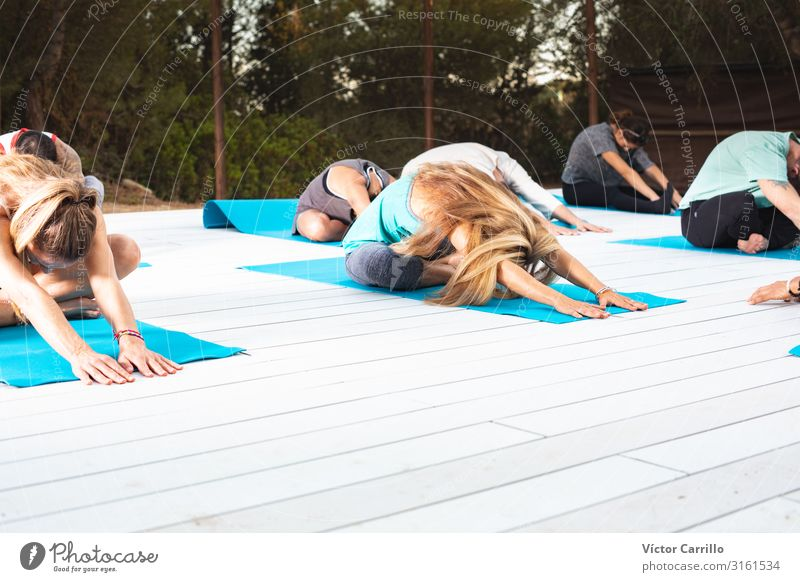 A group of people in a yoga class Lifestyle Elegant Style Human being Masculine Feminine Young woman Youth (Young adults) Young man Woman Adults 6 13 - 18 years