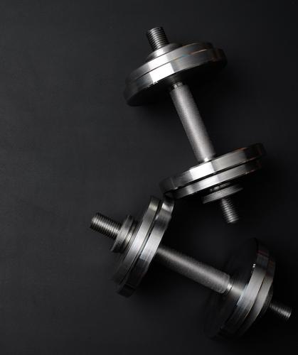 pair of shiny steel typesetting dumbbells for bodybuilding Lifestyle Athletic Sports Tool Metal Steel Fitness Glittering Strong Gray Black Power